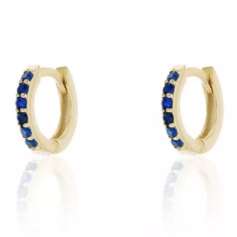Blue and gold huggie hoops