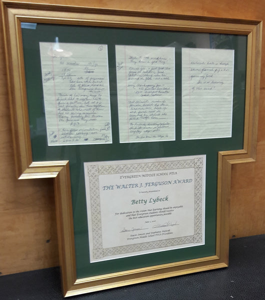 custom-shaped frame for diploma and memorabilia