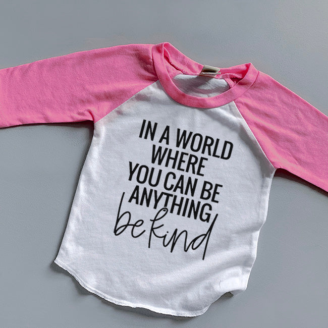 """In a world where you can be anything be kind"" Child Pink/White Raglan"