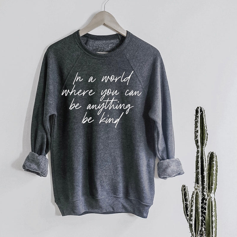 """In a world where you can be anything be kind"" Ladies Dark Heather Charcoal Sweatshirt"