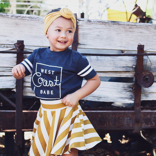 """Westcoast Babe"" Child Football T-Shirt Dark Charcoal with White Stripes"