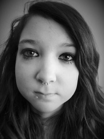 picture of girl wearing flip up septum retainer