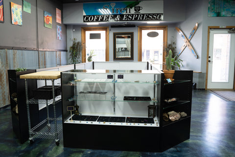 siren body jewelry tattoo and piercing display cases and front entry room