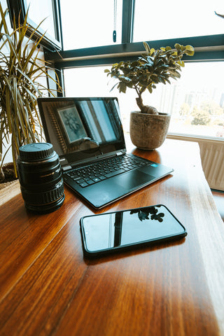 desk with laptop and phone