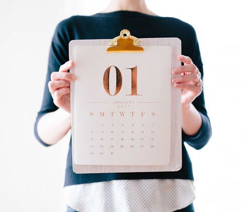 woman holding calender