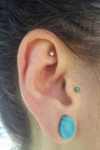 rook piercing with a titanium curved barbell and gems