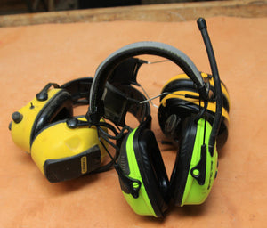 three ear muff noise protectors in a group.