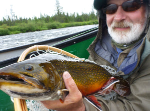 Man holding a large brook trout.