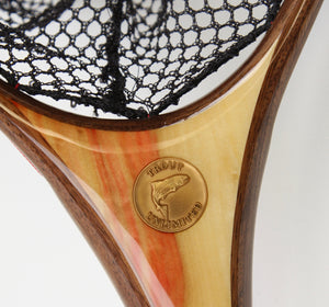 Close up of TU medallion set into handle of hand crafted landing net.