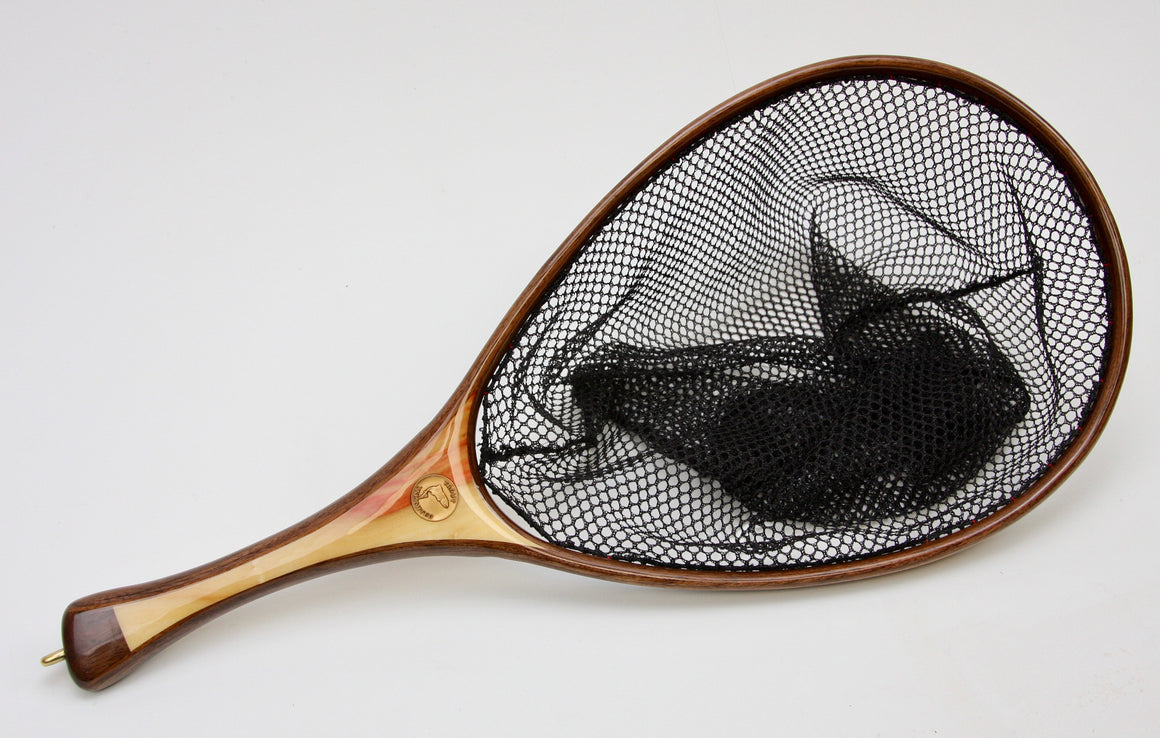 A fly fishing net with walnut hoop and handle of light wood.