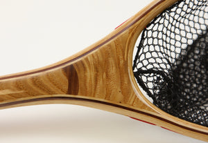 Close up of landing net with walnut inset.