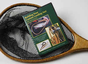 Displays the cover of a DVD laying on a landing net.
