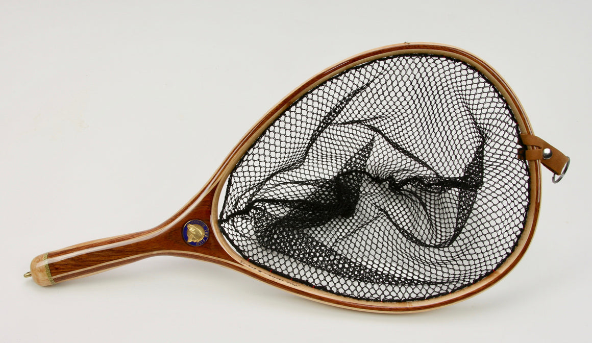 Wooden landing net with brown handle and medallion inset.