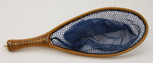 Small trout net with bamboo handle and blue net bag.