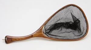 Small trout net with curved handle, brown in color.