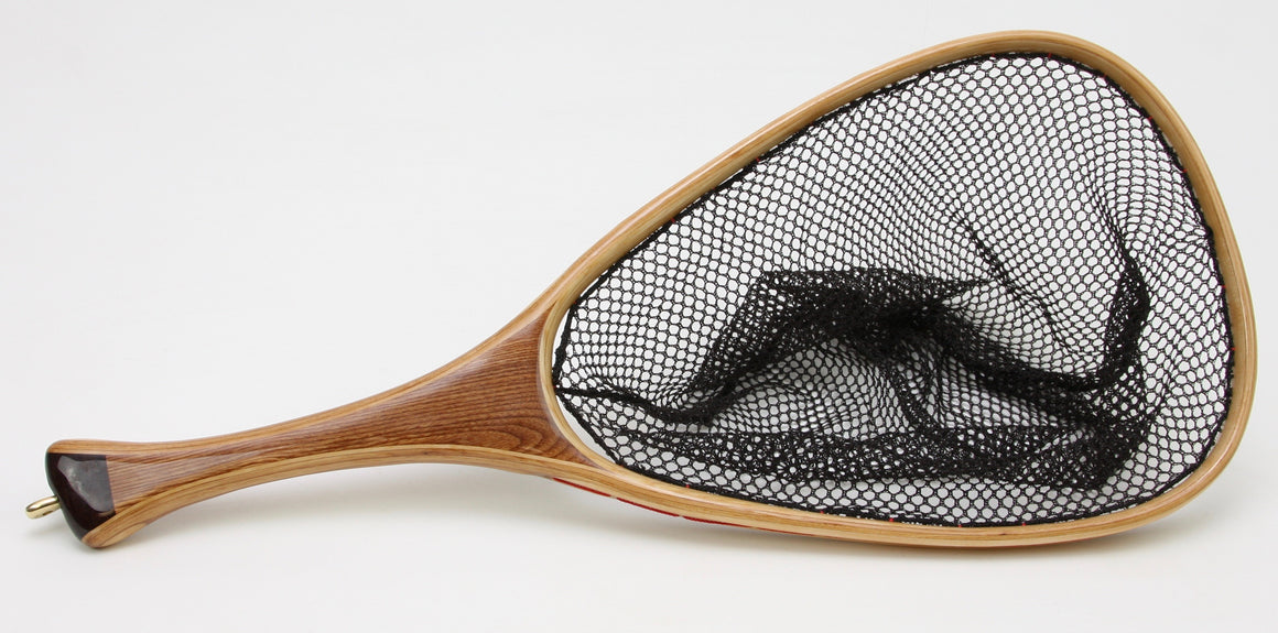 Landing net with very dark handle cap.