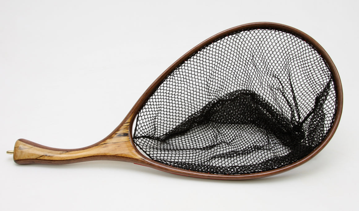 Landing net with curved honey colored handle and dark hoop