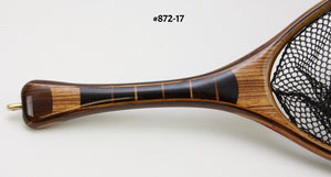 Close up of landing net handle of segmented black palm and zebra wood.