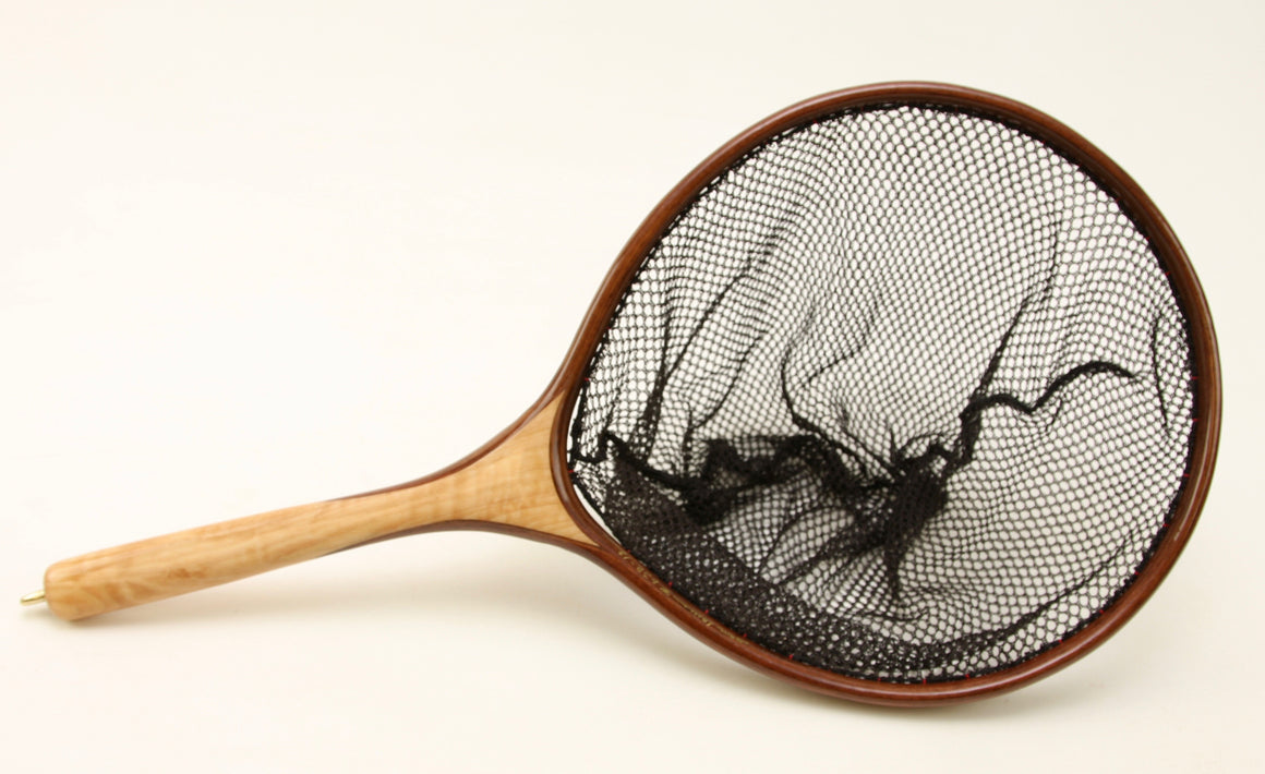 Landing net with a circular hoop, made with light and dark woods.