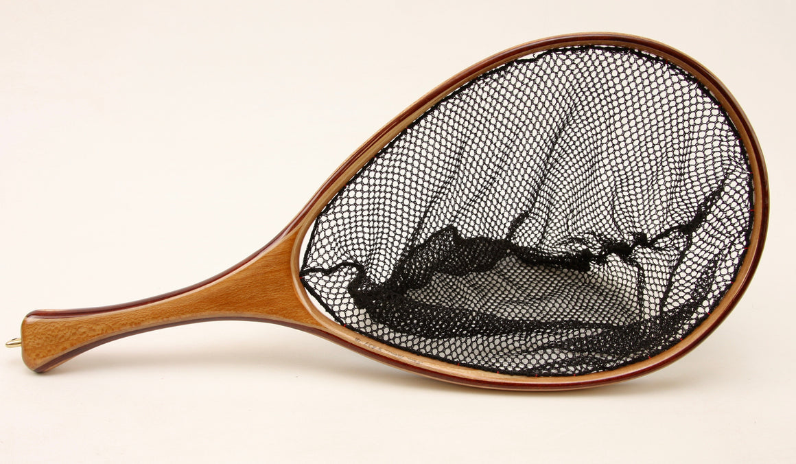 Fly fishing landing net with contrasting light and dark wood.