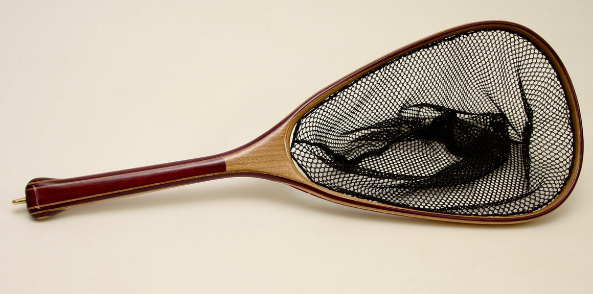 Landing net with purple handle and light wood hoop.