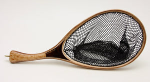 Small trout net with handle that is one half light wood and one half dark wood.