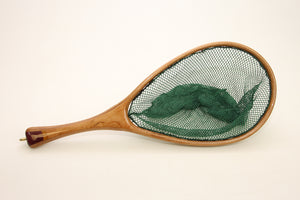 A landing net with cherry and multiple other woods.
