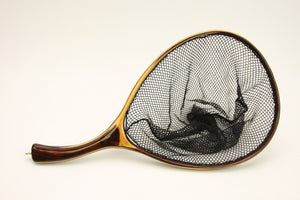 Landing net with contrasting wood colors.