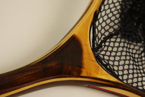 Close up showing of landing net showing the color between sapwood and heart wood.