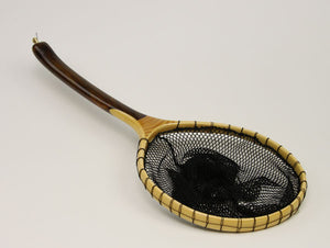 Landing net with dark curved handle.