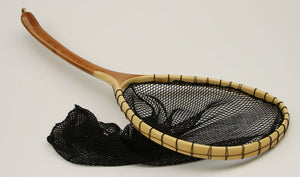 Landing net with curved handle and bamboo hoop.