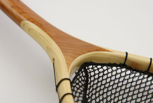 Close up of landing net showing the cherry and bamboo.