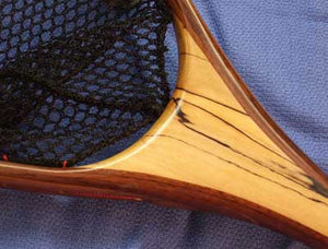 Close up of landing net handle with spalted maple.