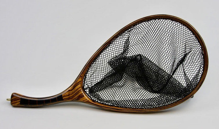 Landing net with segmented black palm handle and zebra wood hoop.