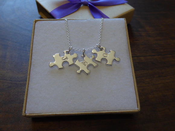 Three Puzzle Charm Necklaces