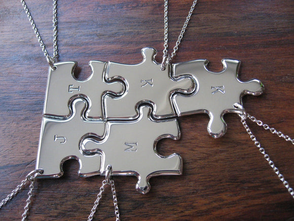 Five Silver Puzzle Necklaces