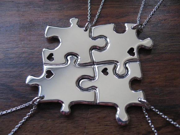 Four Silver Puzzle Necklaces