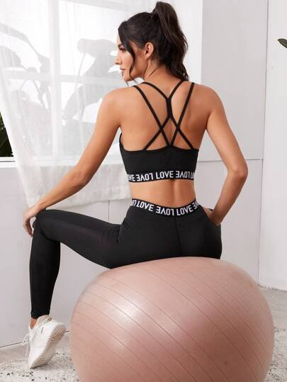 SH518 Letter Graphic Criss Cross Back Sports Bra And Leggings