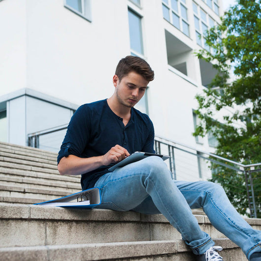 Young man sitting outdoor
