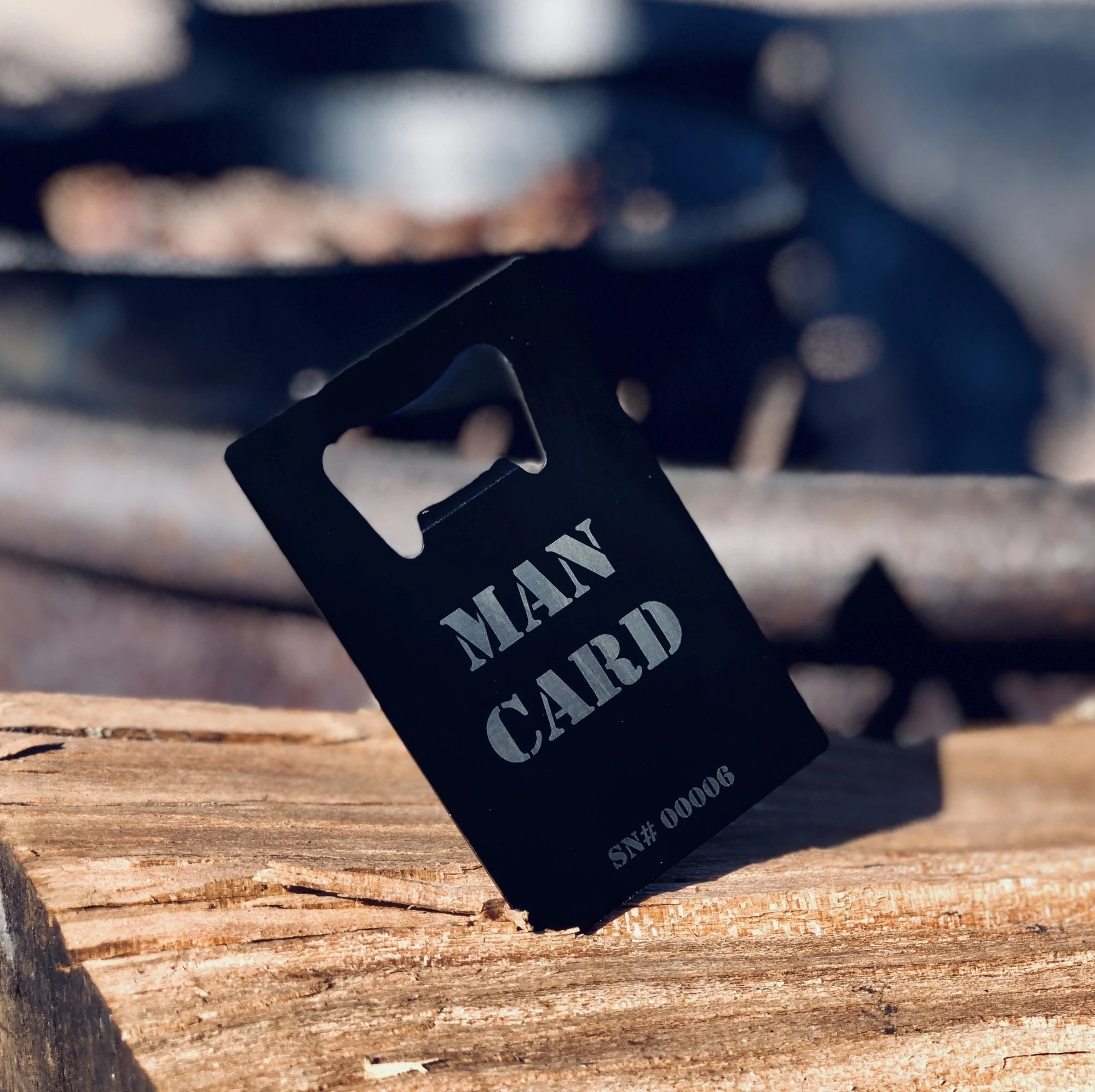 Wallet size MAN CARD beer bottle opener.