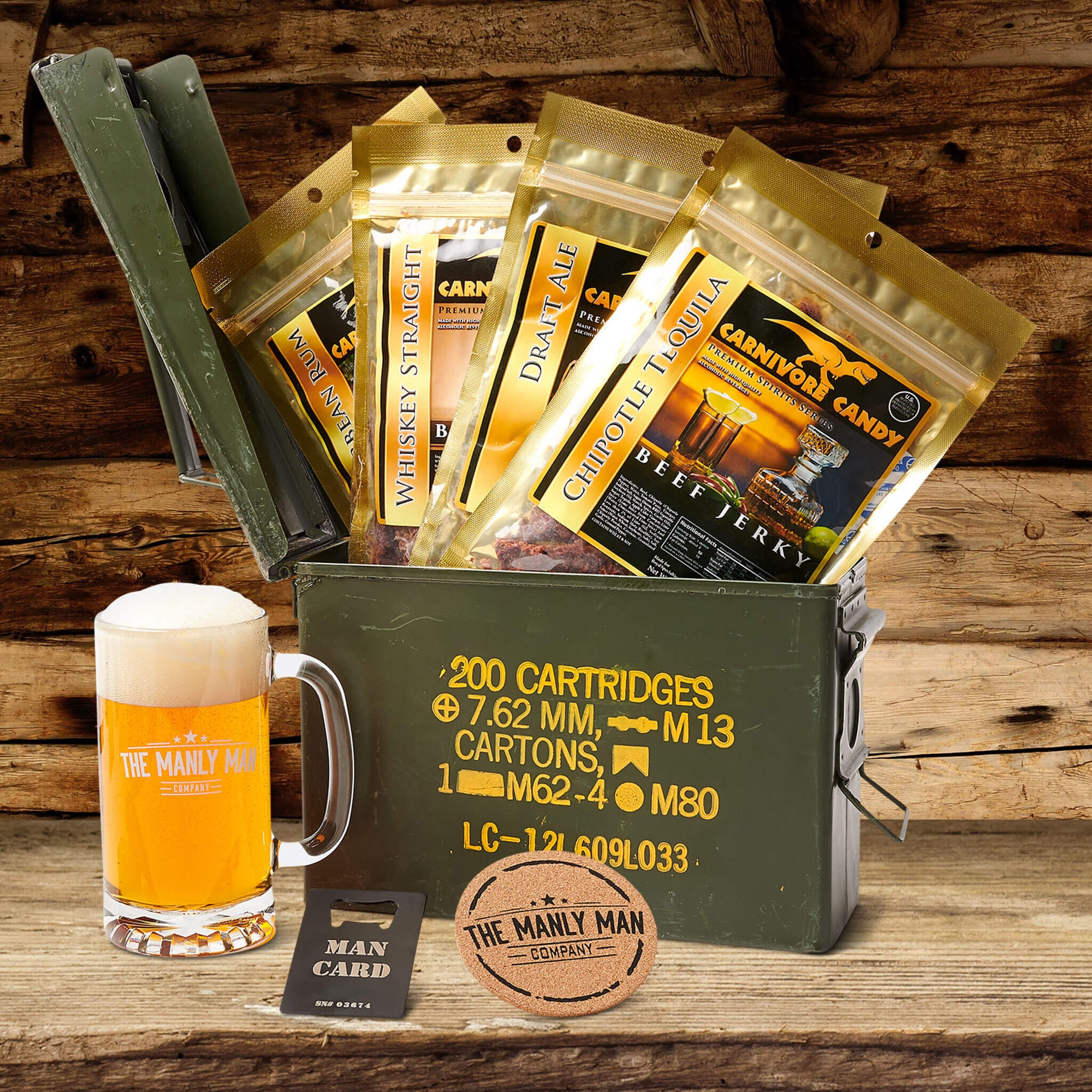 Booze-infused jerky ammo can gift set, sitting on wood table, in front of log cabin background