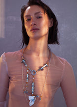We craft the strongest base for all your experiences and keep them safely. So it consists of building materials such as screws, cable covered by plastic and transperant plastic tube. The white detail is also handmaded and carefuly made of melted plastic. Necklace is also decorated with Baltic Amber. Every Mellow piece has it's own life code, so do this one - N4/018. As well it means this product is one of the kind.