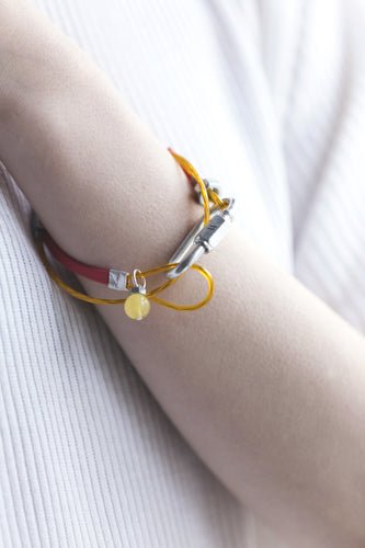 Mellow by Melita Rus bracelet with metal details and Baltic amber stone
