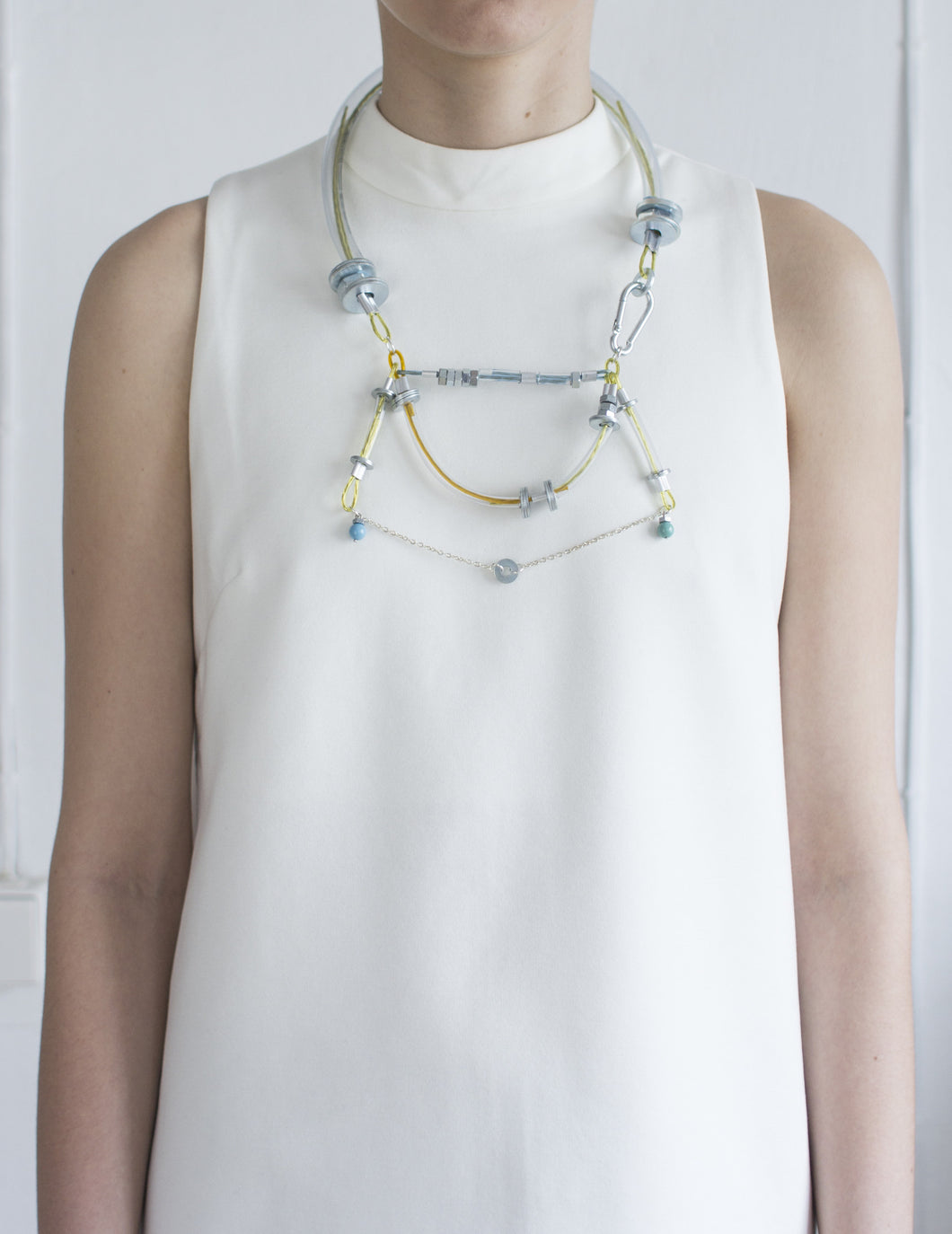 Industrial design necklace with metal details and swarovski pearls