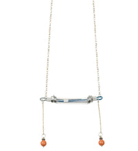 We craft the strongest base for all your experiences and keep them safely. It consists of building materials such as screws, metal cable covered with light blue/nude plastic and transparant tube. Also decorated with orange Swarovski pearls. The length of chain is about 70 cm. Every Mellow piece has it's own life code, so do this one - P6/007