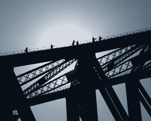 Photograph of a silhouetted bridge.