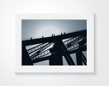 Bridge photo that is framed on the wall.