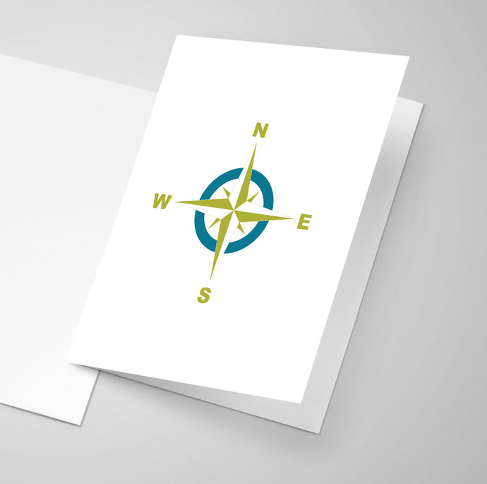 Compass rose on the front of a greeting card in teal and lime colours.