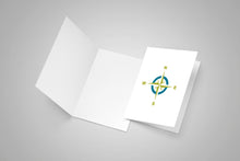 A blank card and second card with a compass rose on the front in teal and lime colours.