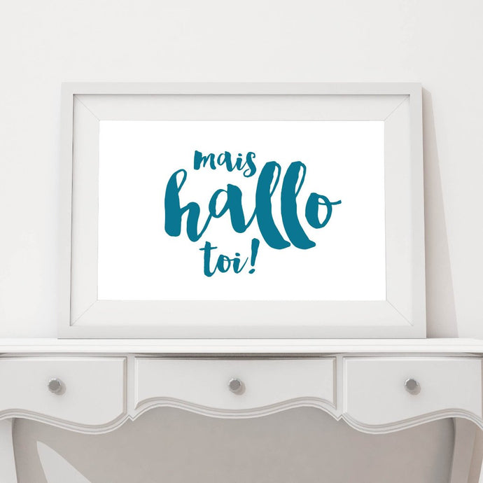 A mais hello toi Acadien/Acadian print in a white frame on a table.